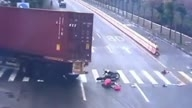 Woman narrowly escapes truck