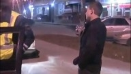 Drunk Russian driver makes phone call with pack of cigarettes